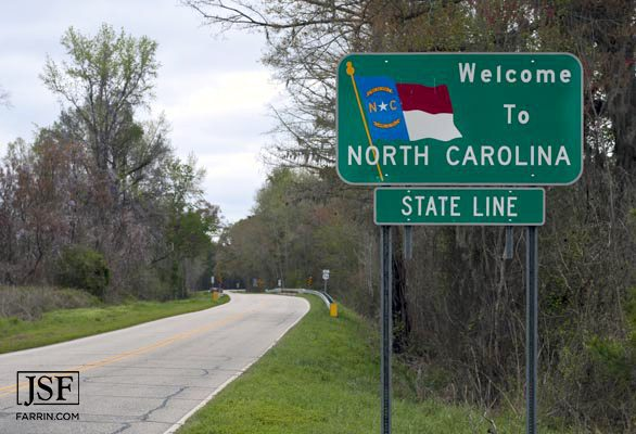 Welcome to North Carolina state line road sign
