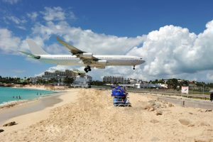 a plane just over a beach about to land