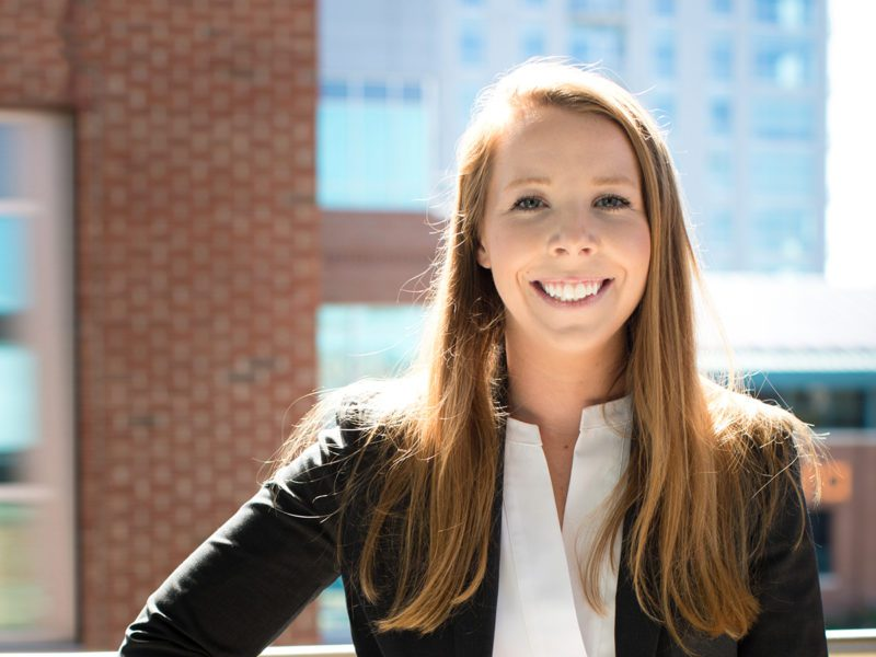 Attorney Kaitlyn Fudge in front of a brick building