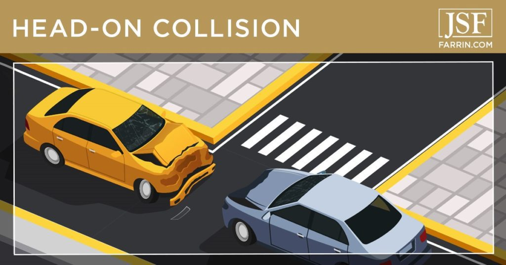 Head-on collision between two cars at an intersection.