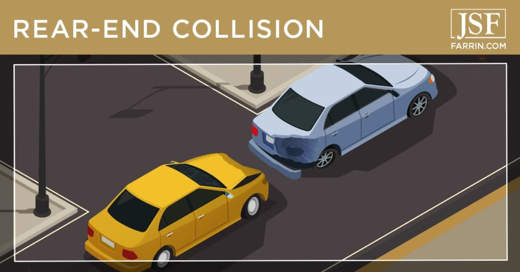 Two damaged cars on a road, caused by a rear-end collision.