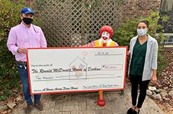 Chelsea Ragan from James Scott Farrin presenting a donation check to Ronald McDonald House in Durham