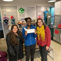 Law Offices of James Scott Farrin making a donation to the Humane Society