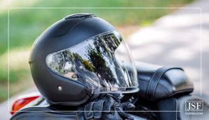 A black motorcycle helmet and leather gloves.