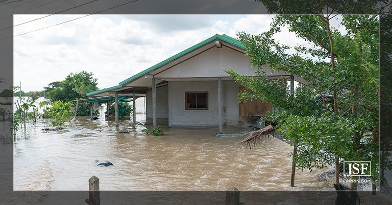 A house damaged by high flood waters, caused by a hurricane storm surge.
