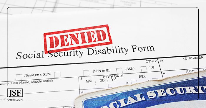 Bright red DENIED stamp on a social security disability application form.