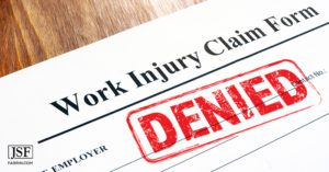 declined claim form for workers' compensation with a red DENIED stamp.
