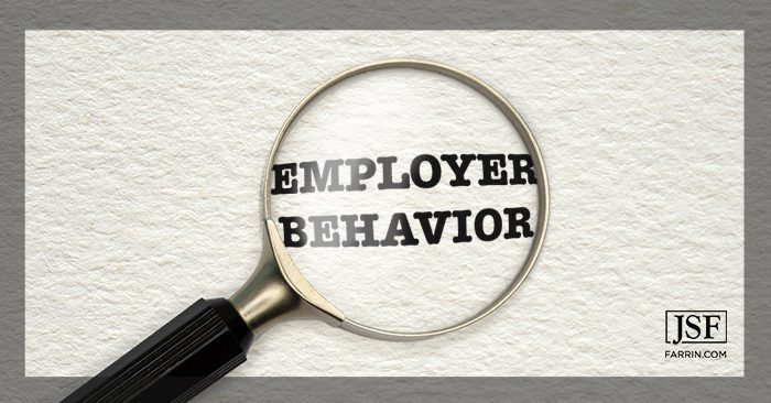 A magnifying glass focusing on the words Employer Behavior.